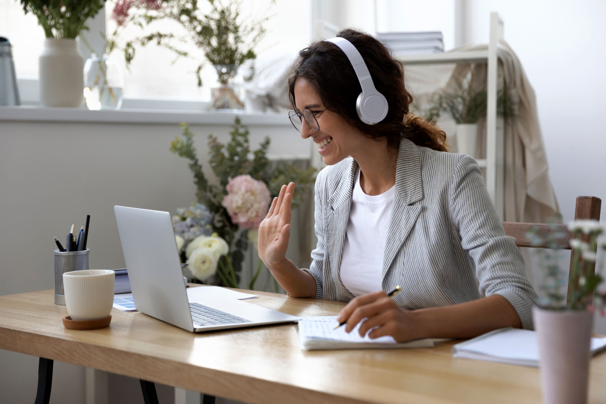 Woman on laptop with headphones